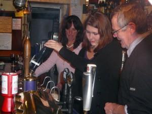 025 Julie Linnea and Jim behind the bar