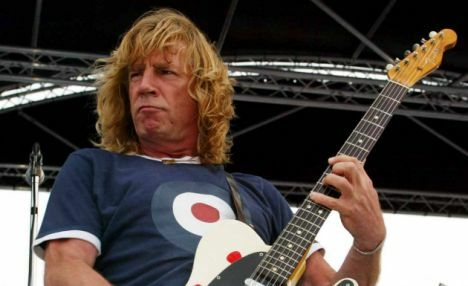 Status Quo performing songs from their new album 'Heavy Traffic' aboard HMS Ark Royal in Portsmouth Docks.